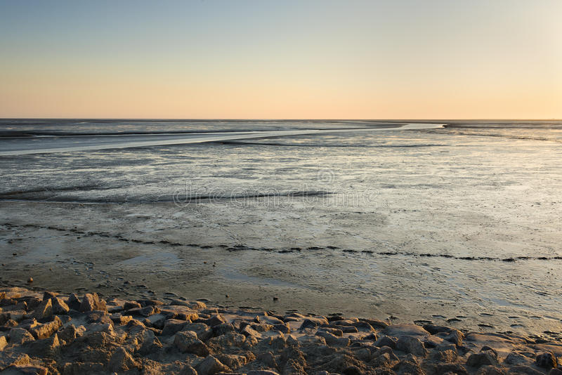 Mudflat landscape at sunset. Image of mudflat landscape in Northern Germany at sunset royalty free stock photography