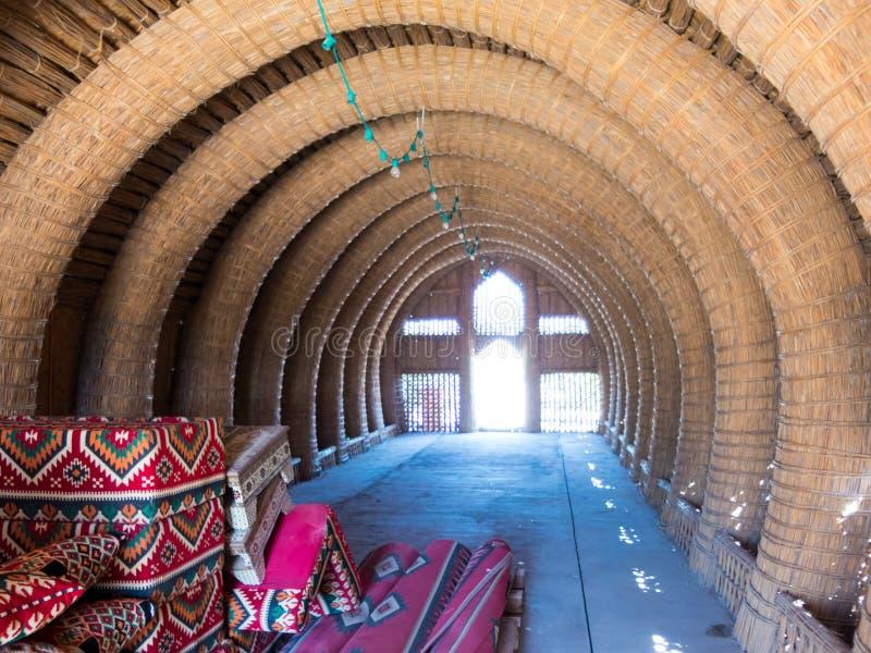Mudhif, casa de lingüeta iraquiana tradicional de Marsh Arabs aka Madan usou-se para a residencial e as cerimônias, Majnoon, Iraq imagem de stock