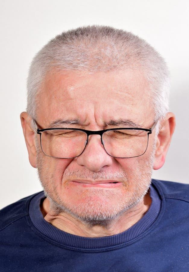 Mueca del viejo hombre imagen de archivo