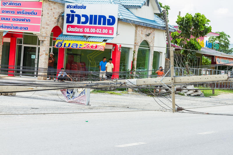 MUENG, PHUKET/THAILAND AUG 2015: Traffic turbulence caused by electricity pole damage on street due to heavy rain disaster on. AUG19, 2015 in Phuket,Thailand royalty free stock images