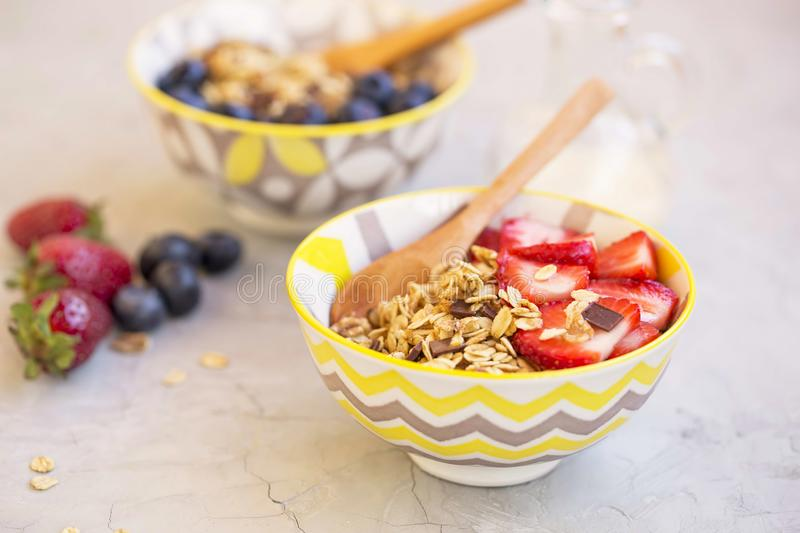 Muesli bowls with strawberries stock images