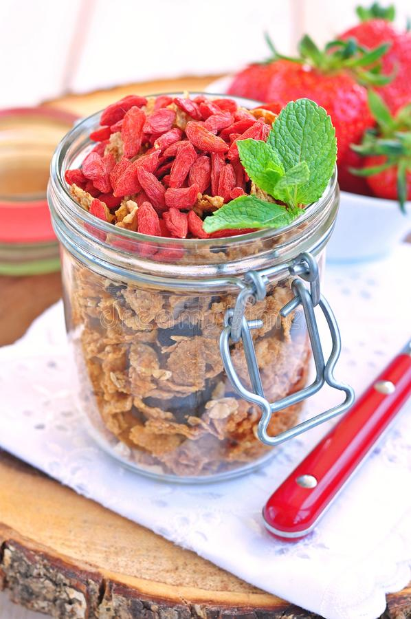 Muesli with dried goji berries and mint on a wooden backgraund. Food stock photo