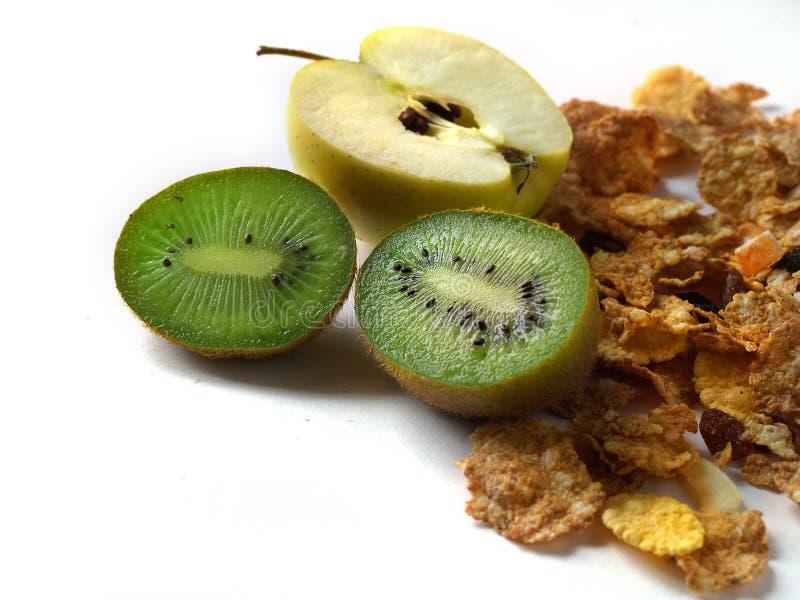 Muesli e kiwi del Apple isolati fotografie stock
