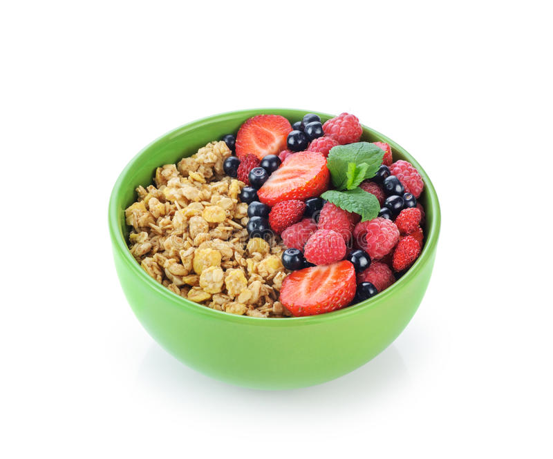 Muesli with fresh berries in a bowl. Isolated on white background. Healthy food royalty free stock photos