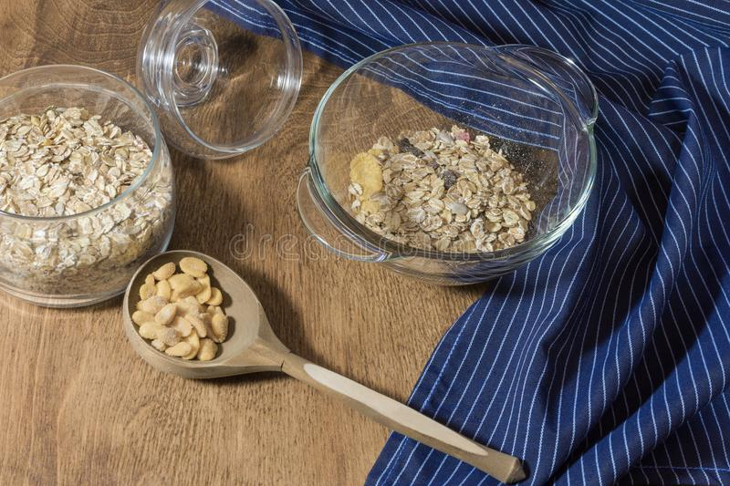 Muesli, granola, cereal and nuts in a glass container on a wooden table. Rustic food. stock photos