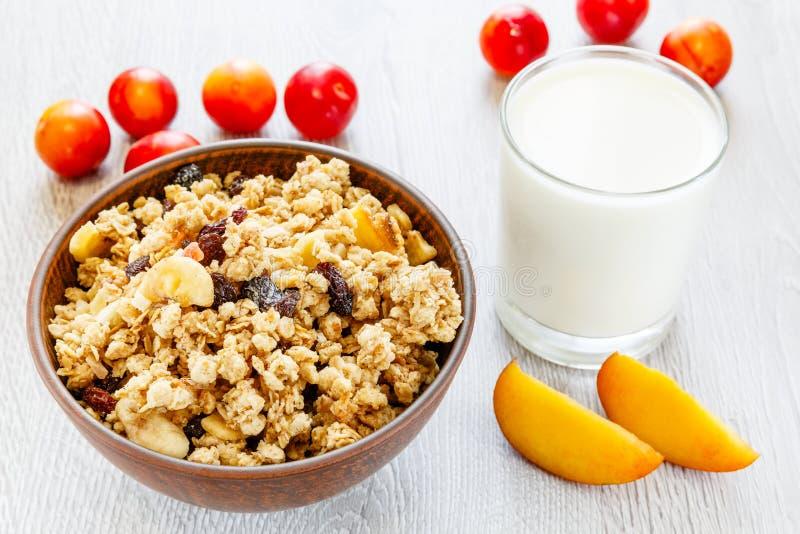 Muesli milk fruit on the table stock images