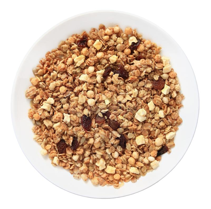 Muesli with raisins on a plate top view isolated on white background with clipping path stock photo