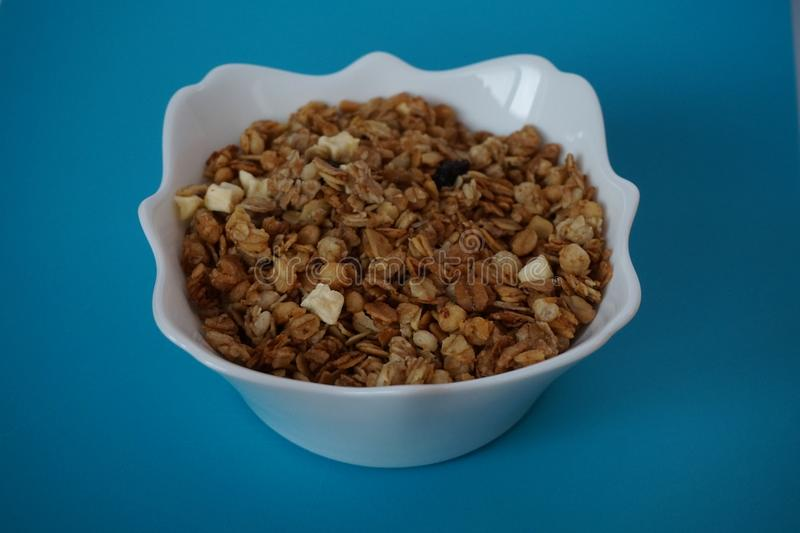 Muesli in a white plate royalty free stock photos