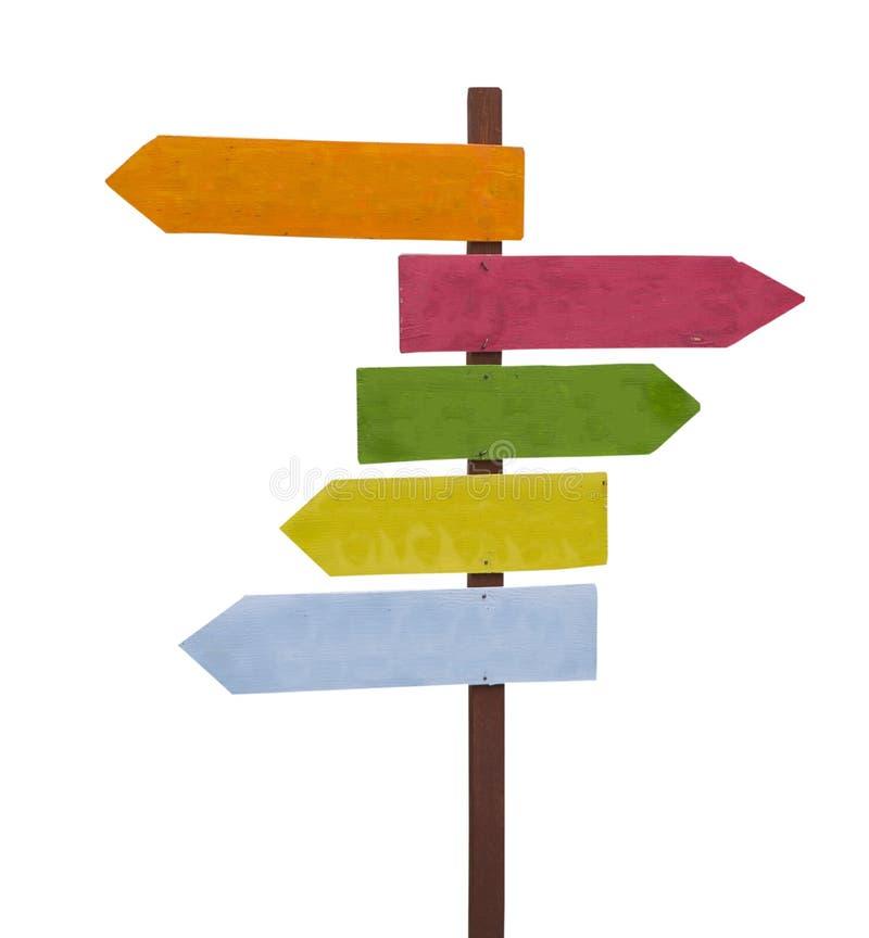 Muestra colorida de la flecha de madera en el fondo blanco fotografía de archivo libre de regalías