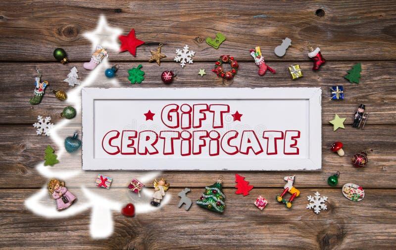 Muestra colorida de madera de la Navidad con el texto y la decoración: ce del regalo stock de ilustración