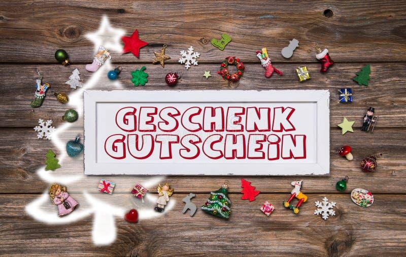 Muestra colorida de madera de la Navidad con el texto y la decoración: ce del regalo libre illustration