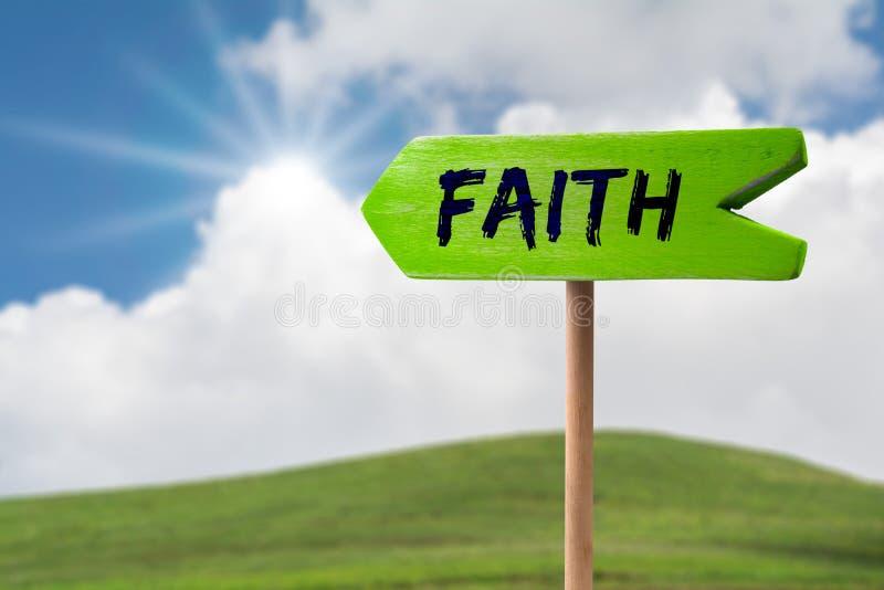 Muestra de la flecha de la fe imagen de archivo