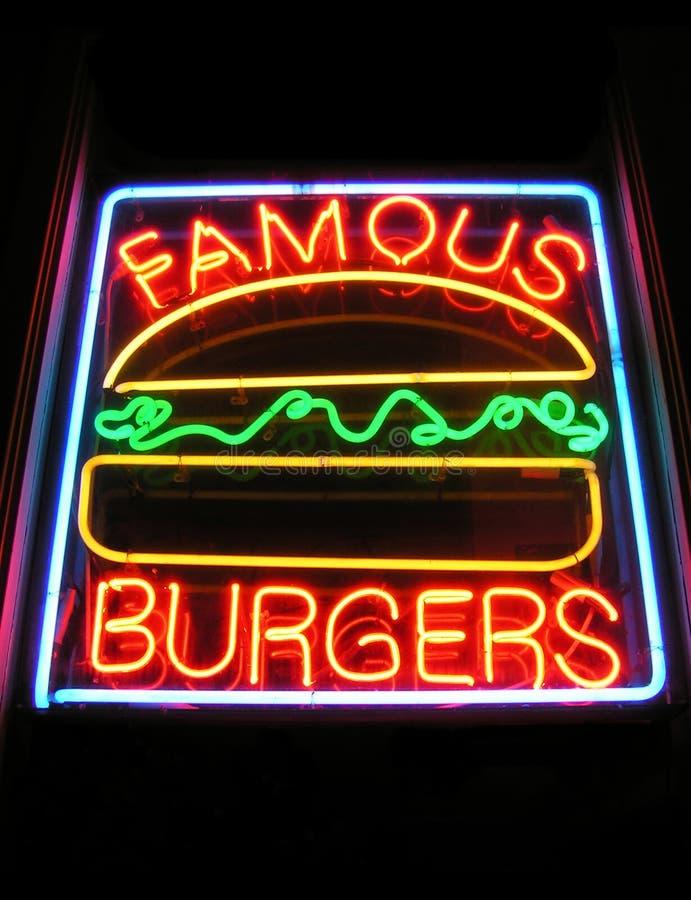 Muestra de neón de la hamburguesa famosa imagen de archivo