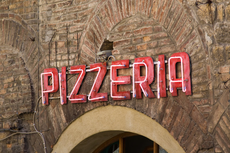Muestra de neón de la pizzería imagenes de archivo