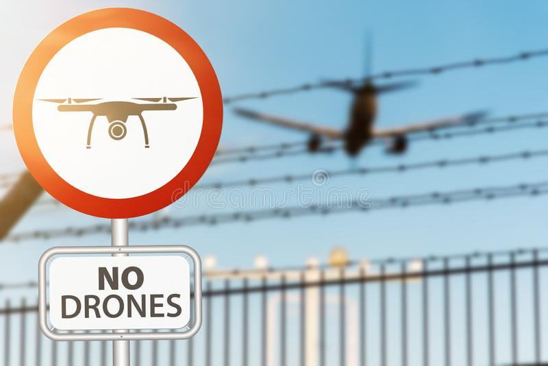 Muestra del prohobition del abejón contra la valla de seguridad y aterrizaje plano en aeropuerto imagen de archivo