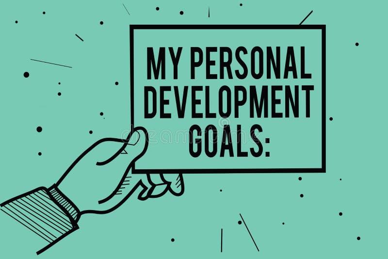 Muestra del texto que muestra mis metas personales del desarrollo La foto conceptual desea la mano del hombre de la planificación stock de ilustración