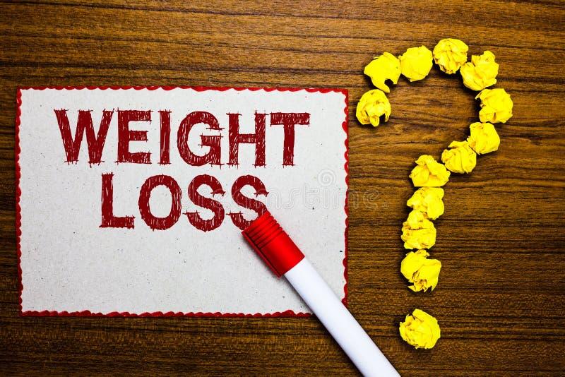 Muestra del texto que muestra pérdida de peso La disminución conceptual de la foto de la masa del músculo del fluído corporal red imagenes de archivo