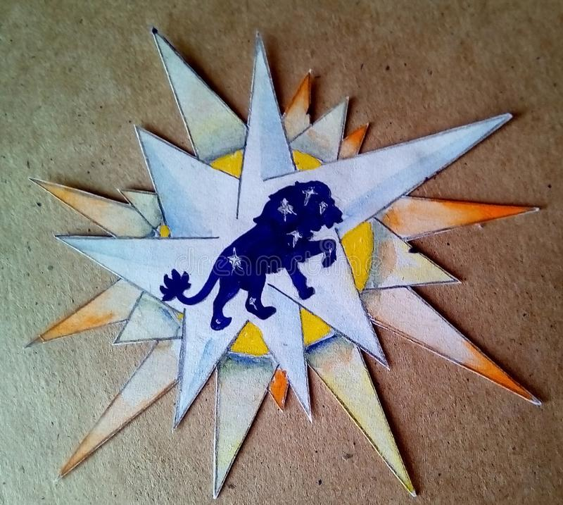 Muestra del zodiaco leo Uso de papel Azul pintado con el león de las estrellas fotos de archivo libres de regalías