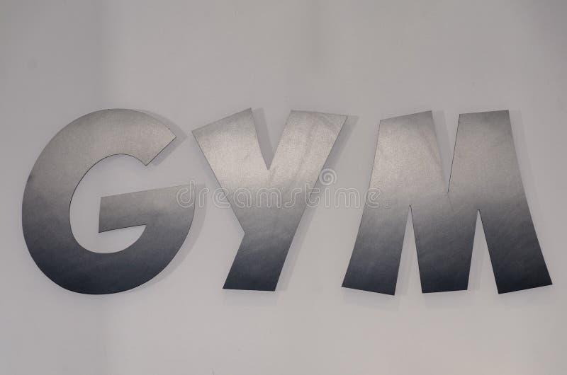 Muestra gris del GIMNASIO con mayúsculas imágenes de archivo libres de regalías