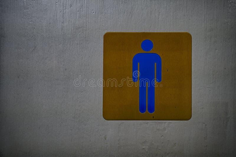 Muestra masculina del cuarto de baño, fondo azul de la muestra y del oro y viejo fotos de archivo libres de regalías