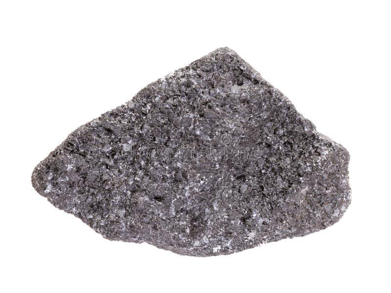 Muestra natural de mineral de la cromita, el mineral más importante del cromo en el fondo blanco fotografía de archivo