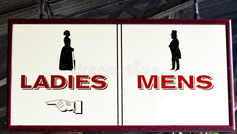 Muestra para hombre y de las señoras de los lavabos imágenes de archivo libres de regalías