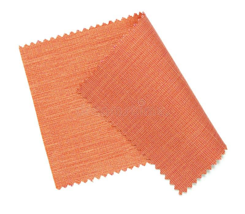 Muestra roja de la tela aislada en blanco   foto de archivo libre de regalías