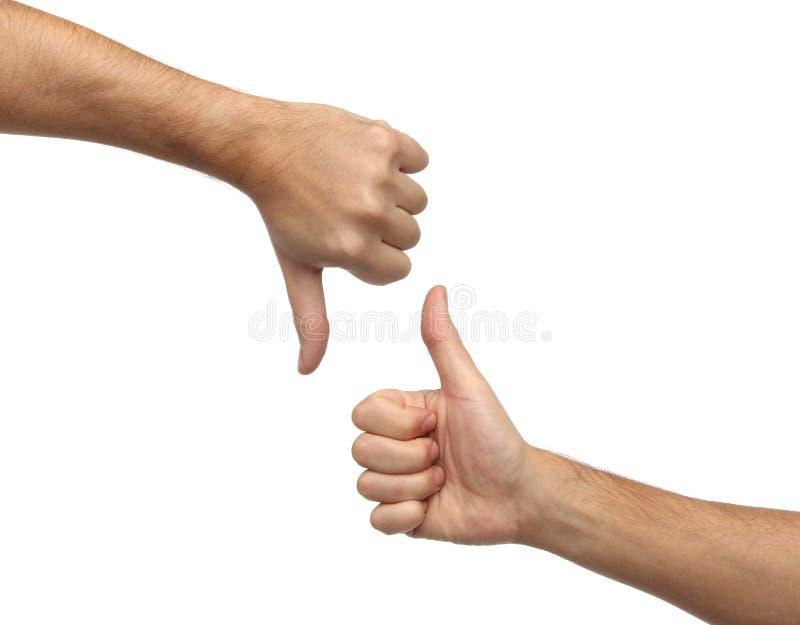 Muestras de las manos Pulgar ascendente y pulgar abajo imagenes de archivo