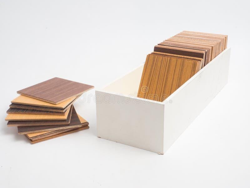 Muestras de madera de la chapa en el fondo blanco sele del diseño interior foto de archivo libre de regalías