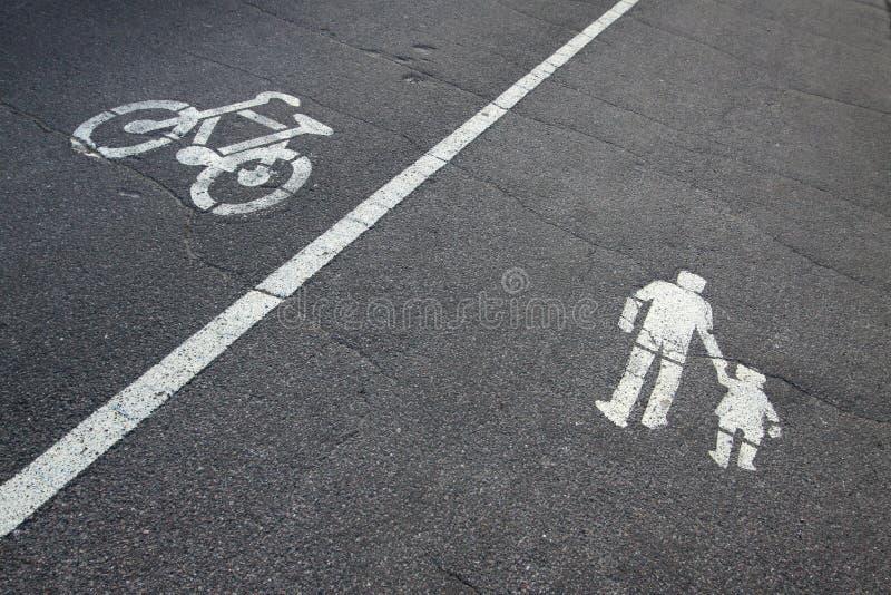 Muestras en el asfalto imagen de archivo