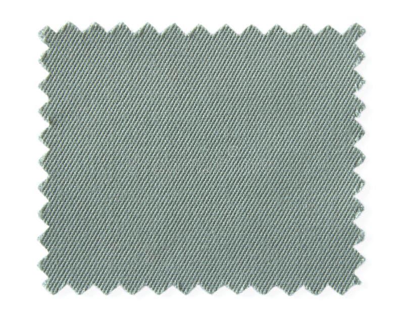 Muestras grises de la muestra de la tela aisladas en blanco fotografía de archivo