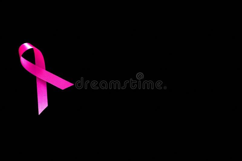 Muestras rosadas de la cinta y del cáncer fotografía de archivo libre de regalías