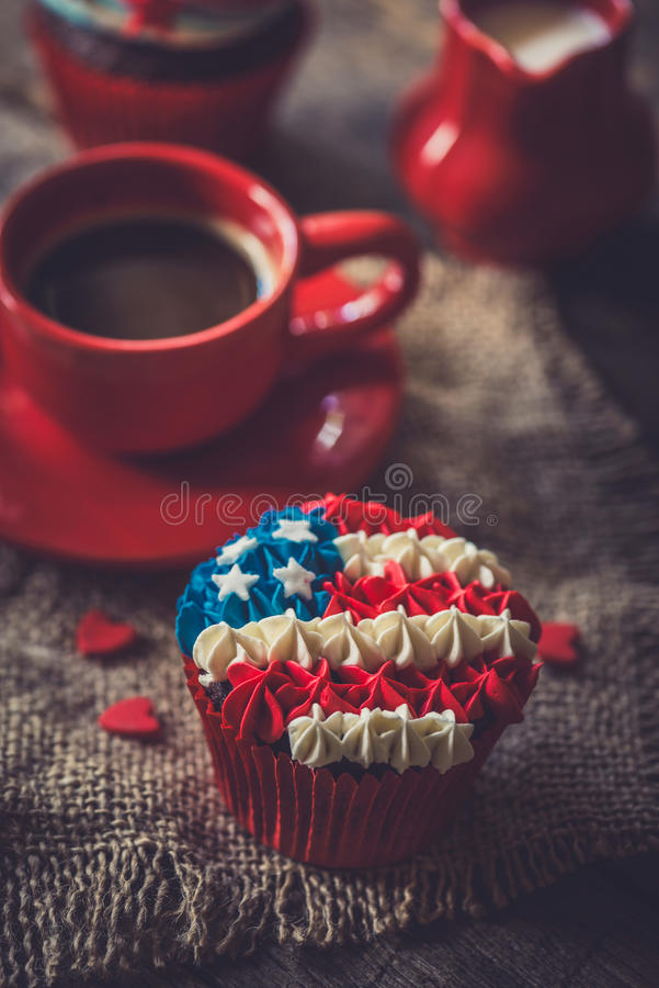 Muffin with American flag. Homemade chocolate muffin with American flag decoration,selective focus stock image