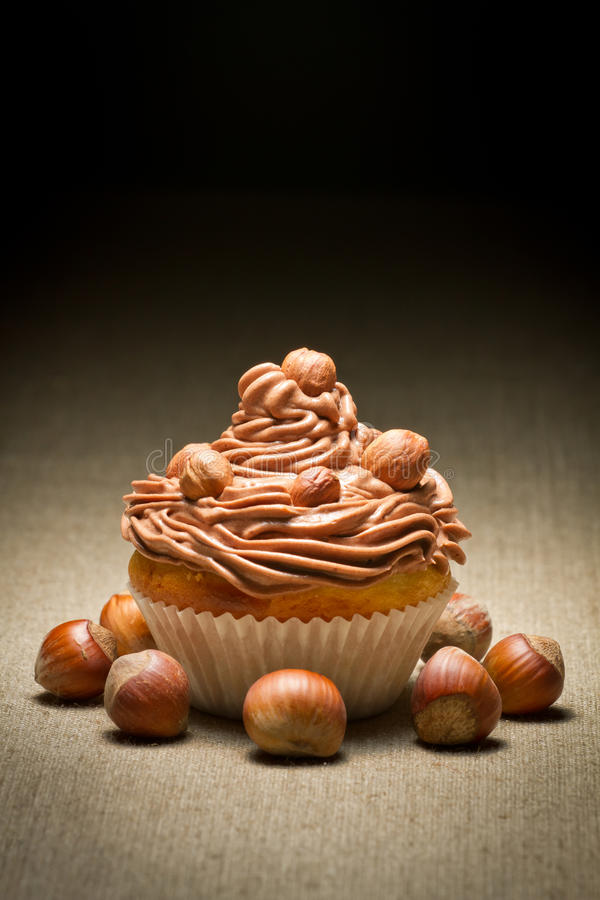 Muffin with chocolate cream and hazelnuts royalty free stock image