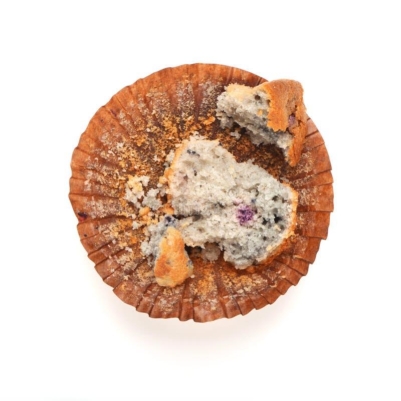 Muffin comido metade fotografia de stock