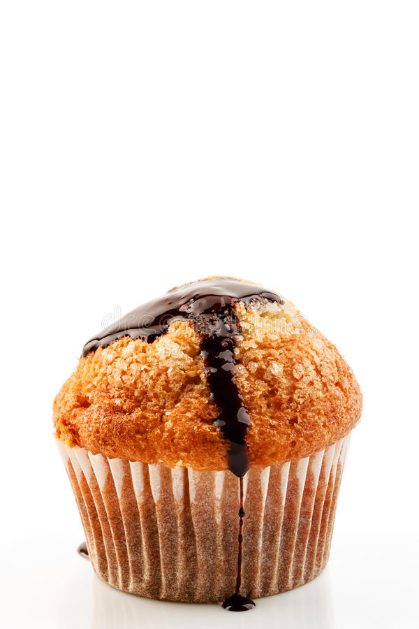 Muffin with liquid chocolate stock photos