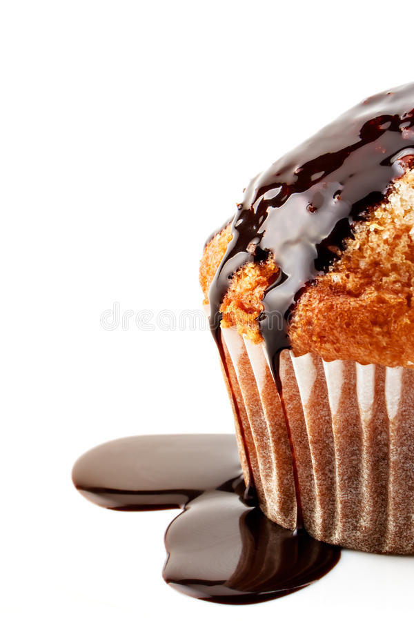 Muffin with liquid chocolate royalty free stock photography