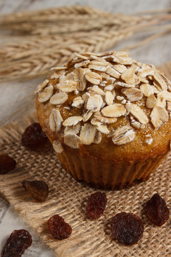 Muffin with oatmeal baked with wholemeal flour and ears of rye grain, delicious healthy dessert concept stock photos