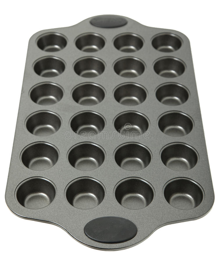 Muffin Pan On White Background royalty free stock images