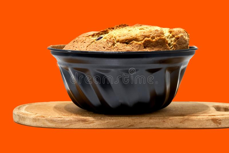 Muffin pie lies on a wooden board, bake stock photo