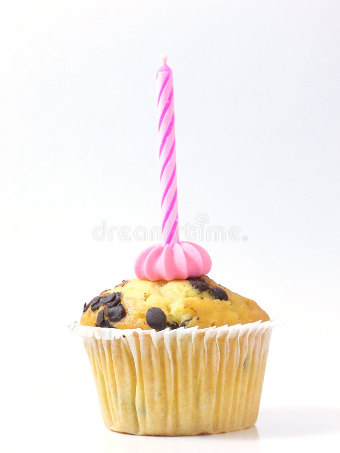 Muffin and pink candle