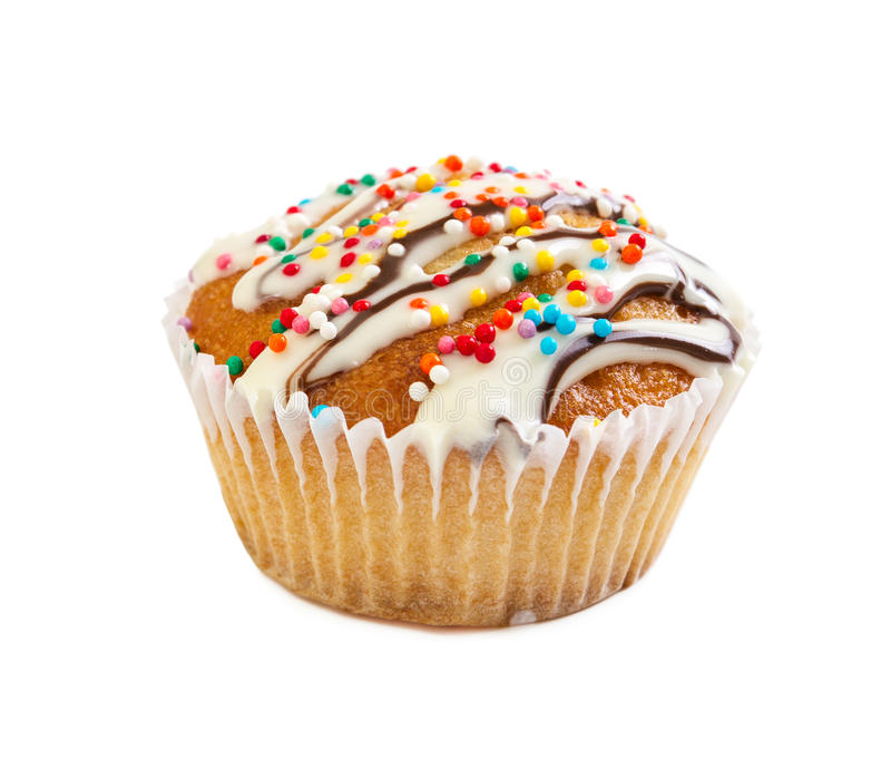 Muffin poured white liquid chocolate syrup and decorated with ca. Ndy sprinkles isolated on white background royalty free stock photos