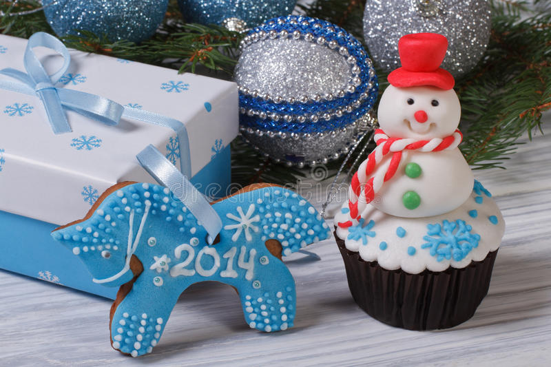 Muffin snowman and gingerbread horse. Christmas decor: muffin snowman and gingerbread horse stock images