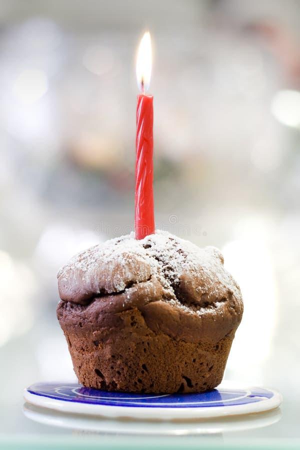 Muffin und Kerze stockfoto