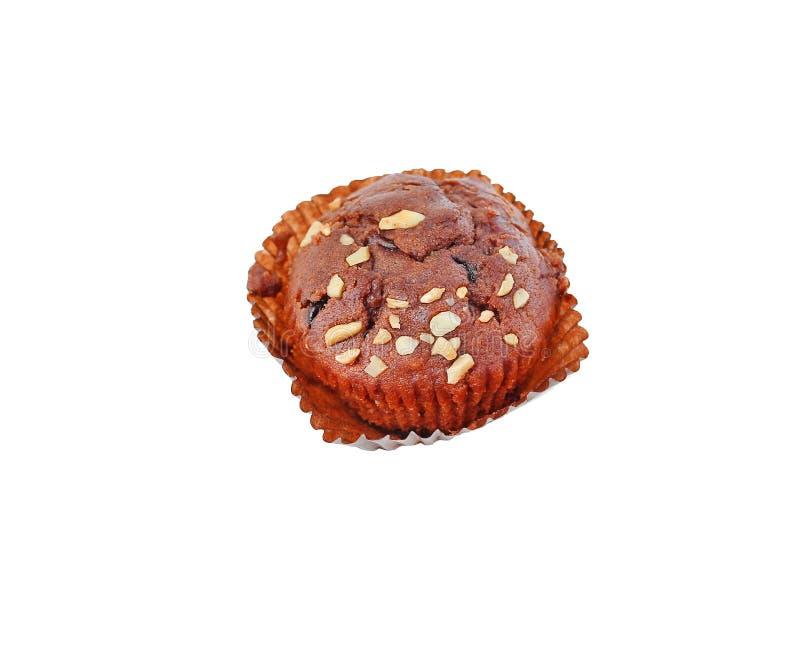 Muffin van banaan de bruine die cupcake met noot wordt bedekt op witte Achtergrond wordt geïsoleerd stock foto's
