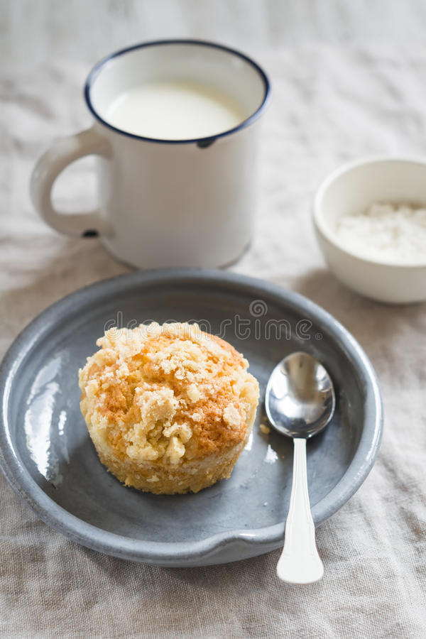 Muffin in a vintage plate and a mug of milk stock images