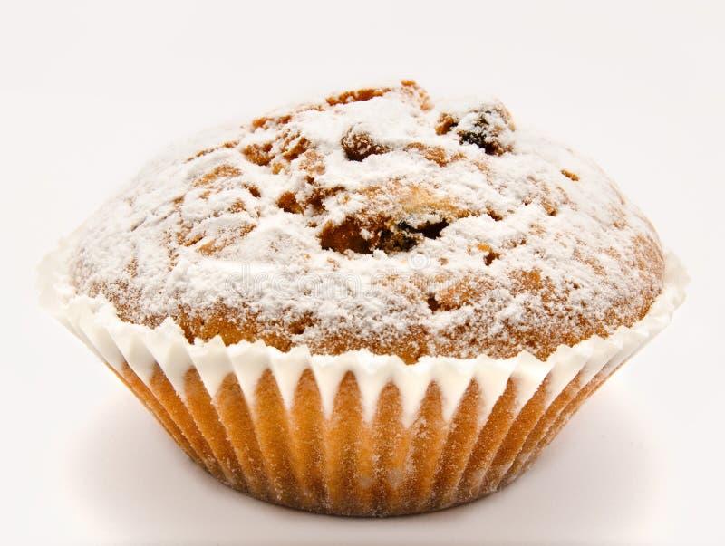 MuffinPuderzucker auf einem Weiß lizenzfreies stockbild