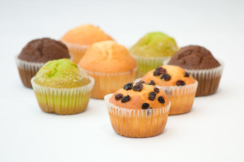 Muffins. Assorted colourful muffins royalty free stock images