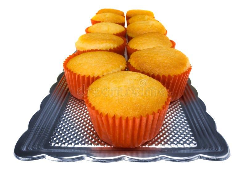 Muffins auf Weiß lizenzfreie stockfotografie