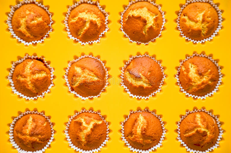 Muffins, cakes, bread rolls in a baking dish. stock photography